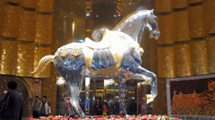 MGM Macau Hotel Casino Horse Statue sculpture guests coming in and out China Stock Footage