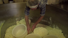 Filling molds with cheese curd [Slomo] - stock footage