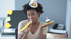 Unhappy Black woman in office celebrating a birthday Stock Footage