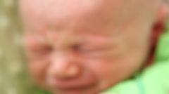 Crying Caucasian newborn baby Stock Footage