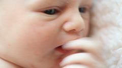 Close up of a Caucasian newborn's face with open eyes Stock Footage