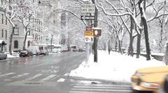 Cars and snow on Fifth Avenue, New York City Stock Footage