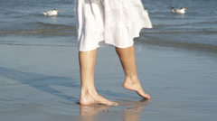 Feet of Caucasian woman at beach Stock Footage