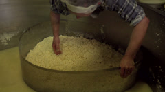 Mixing herbs through the Cheese Curd [Slomo] - stock footage