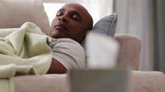 Black man sleeping on sofa Stock Footage