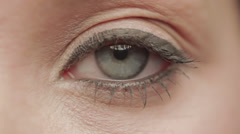 Close up of blue eye of caucasian woman Stock Footage