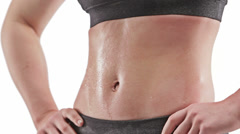 Athletic caucasian woman sweating with hands on hips showing abdomen Stock Footage