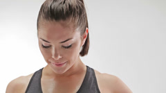Athletic caucasian woman sweating and looking at camera Stock Footage