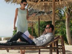 Business couple with cellphone and documents in exotic resort NTSC Stock Footage