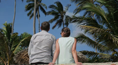 Business couple sitting and relaxing in exotic location HD Stock Footage
