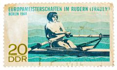 postcard printed in the ddr shows championship european rowing (women) - stock photo