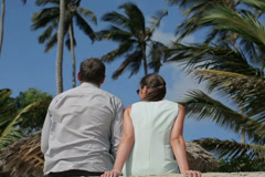 Business couple sitting and relaxing in exotic location NTSC Stock Footage