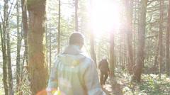 Caucasian women walking down hiking trail in woods Stock Footage