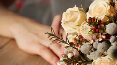 Hands next to wedding bouquet Stock Footage