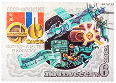 stamp printed by russia, shows intercosmos cooperative space program (ussr-fr - stock photo