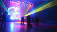 discotheque, people dancing during disco party under colorful lights - stock footage