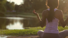 Sitting black woman doing yoga Stock Footage
