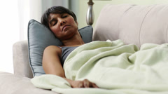 Mixed race woman sleeping on sofa Stock Footage