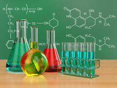 Stock Illustration of chemical flasks and blackboard with formulas.