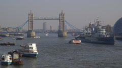 View across the River Thames to Tower Bridge and HMS Belfast Stock Footage