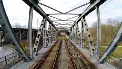 Flying trough bridge construction. aerial view. old bridge. rail road tracks Stock Footage