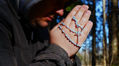 Religious man with a rosary episode 2 - stock footage