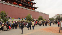 People are gathering in font of Jianshui city gate - stock footage