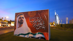 Time Lapse Dubai Shaikh Mohammed billboard and Burj Al Arab at dusk UAE Stock Footage