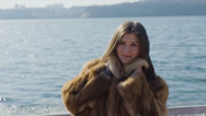 Stock Video Footage of Beautiful young girl outdoors in a fur vest 14-bit RAW