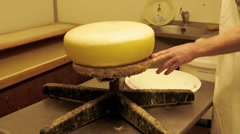 Stock Video Footage of Coating Cheese With a Layer of Plastic