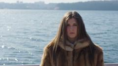 Beautiful young woman in fur mourns the yard 14-bit RAW Stock Footage