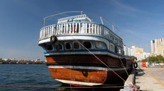 Dubai Creek River Dau (Dhau) boat at Blu Dubai pier  UAE Stock Footage