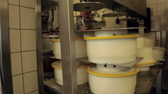 Pressing a mold with curd to Goude cheese Stock Footage
