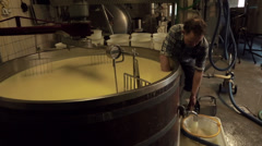 Cheese Whey Flows Away Stock Footage