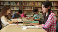 Junior high students studying in library - stock footage