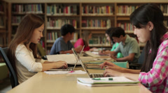 Junior high students studying in library Stock Footage