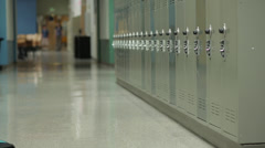 Junior high students with backpacks in corridor Stock Footage