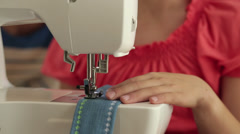 Close up of mixed race girl using sewing machine Stock Footage