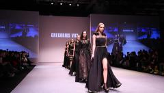 Super models Haute Couture catwalk high fashion runway Fashion Week Stock Footage
