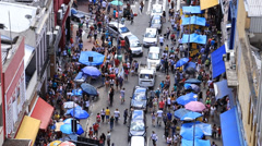 Hundreds of People walk along the 25 March area in Sao Paulo - stock footage