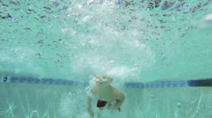 Caucasian boy swimming underwater Stock Footage