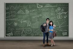 Stock Illustration of college students showing thumbs-up