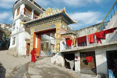 Buddhist monk entering zigar drikung kagyud institute in rewalsar,india Stock Photos