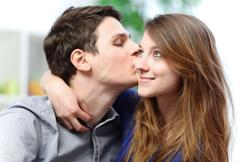 handsome young man embracing his girlfriend with love - stock photo