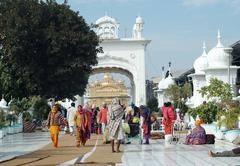 worshippers are visiting famous golden temple,amritsar,INdia - stock photo