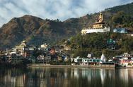 Stock Photo of sacred rewalsar lake with big golden statue of padmasambhava ,India