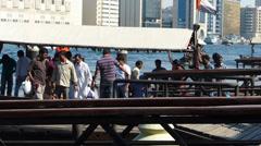 Dubai Blu Dubai Abra ferry full of foreign workers commuters crossing creek Stock Footage