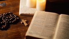 Pan from crucifix to Bible - stock footage