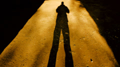 silhouette shadow of a person. people male men. walking. light and darkness - stock footage