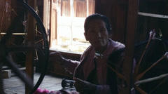 Traditional burmese textile manufacture in Inle Lake craft village. Burma Stock Footage
